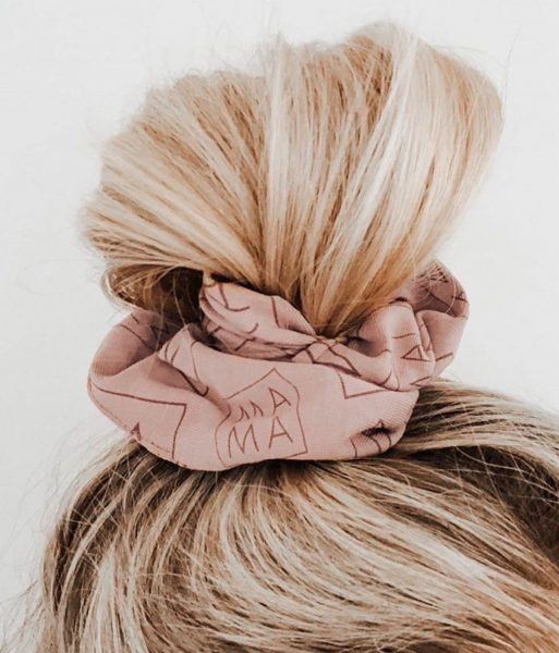 woman with topknot and MAMA scrunchie in her hair