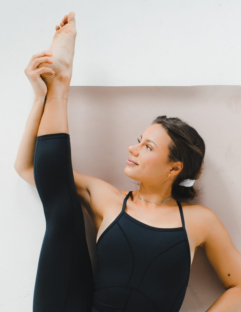 woman stretching with active Zenchie in her hair