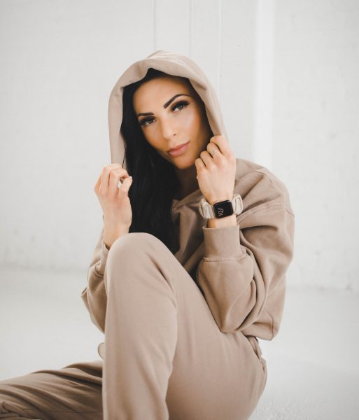 woman in beige monochrome outfit wearing nude apple watch band